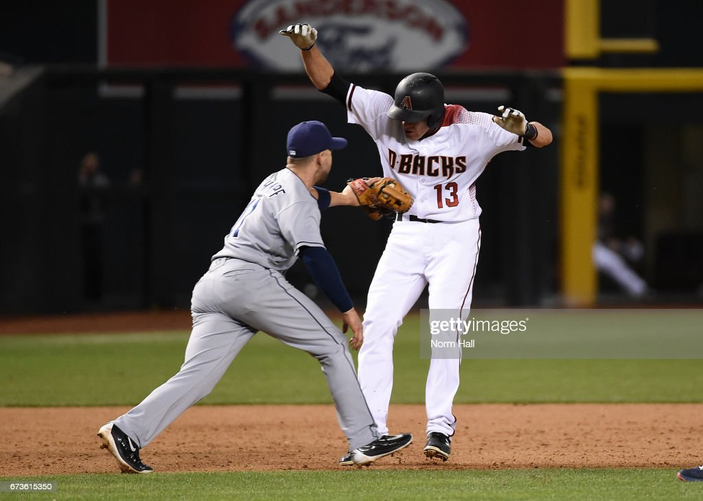 Ryan Schimpf #11 of the San Diego Padres tags out Nick Ahmed #13 of the Arizona Diamondbacks after getting picked off of second base at Chase Field on April 26, 2017 in Phoenix, Arizona. Padres won 8-5.