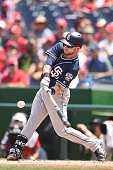 Ryan Schimpf of the San Diego Padres takes a swing during a baseball game against the Washington Nationals at Nationals Park on July 24 2016 in...