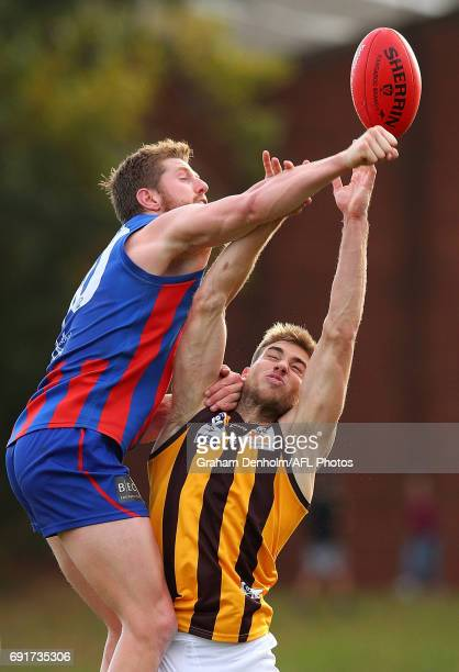 Ryan Schoenmakers of Box Hill and Brodie Murdoch of Port Melbourne compete for the ball during the round seven VFL match between Port Melbourne and...
