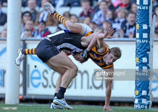 Ryan Schoenmakers of the Hawks and Travis Cloke of the Magpies tussle in the goal mouth during the round 17 AFL match between the Collingwood Magpies...