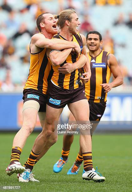 Ryan Schoenmakers of the Hawks is congratulated by Jarryd Roughead after kicking a goal during the round seven AFL match between the Hawthorn Hawks...