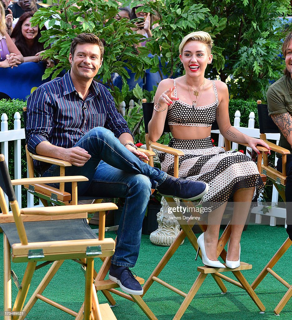 Ryan Seacrest and Miley Cyrus visit ABC's 'Good Morning America' on July 15, 2013 in New York, United States.