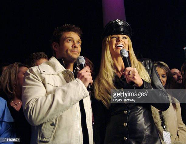 Ryan Seacrest and Nikki Ziering at the American Wedding DVD release party December 28 2003