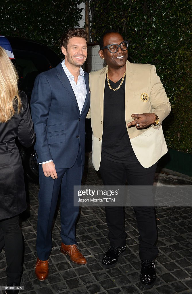 Ryan Seacrest and Randy Jackson arrive at the Topshop Topman LA Opening Party at Cecconi's West Hollywood on February 13, 2013 in Los Angeles, California.