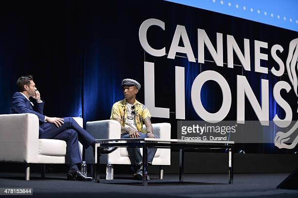 Ryan Seacrest interviews Pharrell Williams for the iHeart Seminar during the Cannes Lions International Festival of Creativity on June 23 2015 in...
