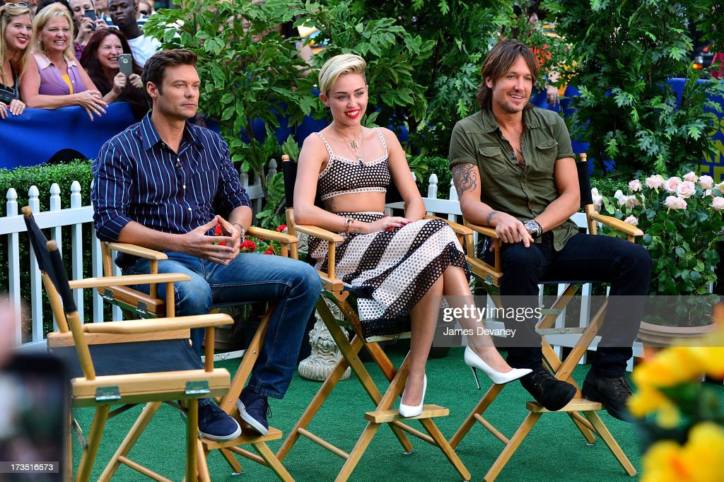 Ryan Seacrest, Miley Cyrus and Keith Urban visit ABC's 'Good Morning America' on July 15, 2013 in New York, United States.