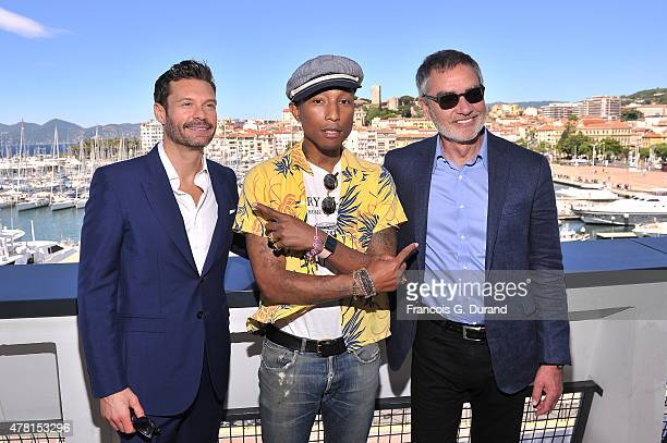 Ryan Seacrest Pharrell Williams and Bob Pittman Chairman and CEO of iHeartMedia Inc pose on the balcony of the Palais des Festivals after the iHeart...