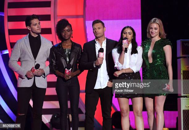 Ryan Seacrest with Casey Cott Ashleigh Murray Camila Mendes and Lili Reinhart speak onstage during the 2017 iHeartRadio Music Festival at TMobile...