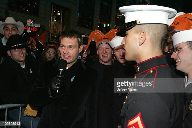Ryan Seacrest with US Navy and Marine personnel in Times Square