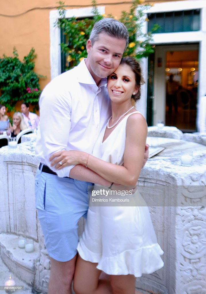 Ryan Serhant and Emilia Bechrakis pose prior to the wedding festivities of television personality Ryan Serhant and Emilia Bechrakis on July 6 2016 in...