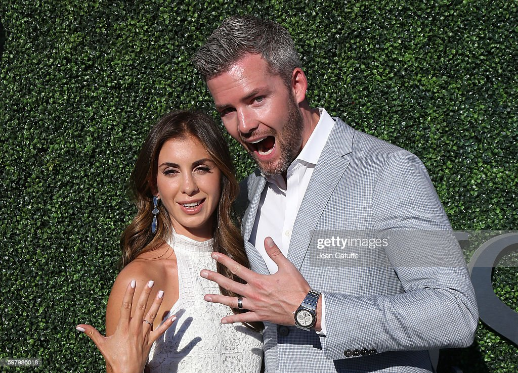Ryan Serhant and Emilia Bechrakis who just got married show their wedding rings during the 2016 US Open opening night at USTA Billie Jean King...