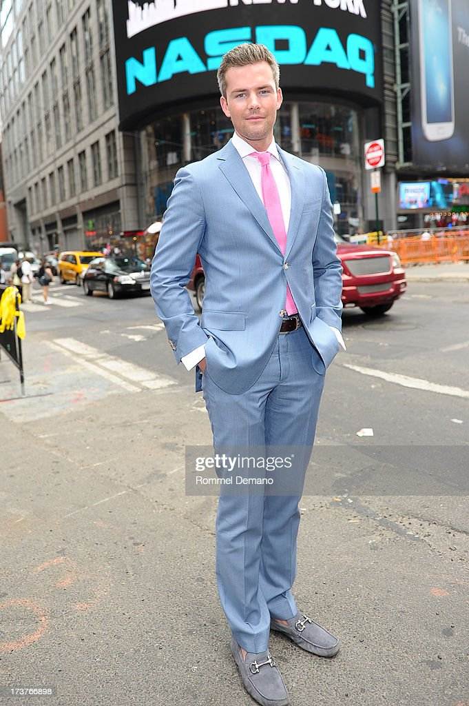 Ryan Serhant rings the NASDAQ closing bell at NASDAQ MarketSite on July 17, 2013 in New York City.