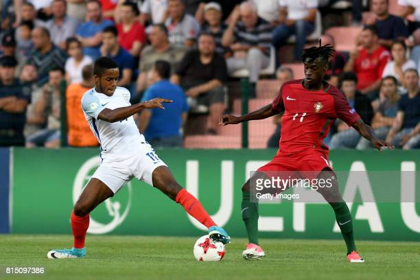 Ryan Sessegnon of England in action with Mesaque Dju of Portugal during the UEFA European Under19 Championship Final between England and Portugal on...