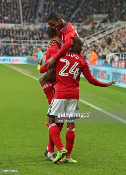 Ryan Sessegnon of Fulham celebrates on top of his teammates after he scores the third goal during the Sky Bet Championship match between Newcastle...