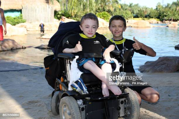 Ryan Shannon from Belfast and Michael Bowes from County Tyrone after swimming with dolphins at Discovery Cove Orlando Florida as part of the annual...