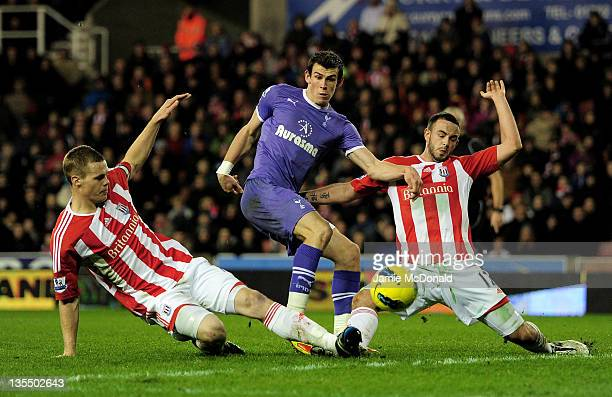 Ryan Shawcross and Marc Wilson of Stoke City challenge Gareth Bale of Tottenham Hotspur during the Barclays Premier League match between Stoke City...