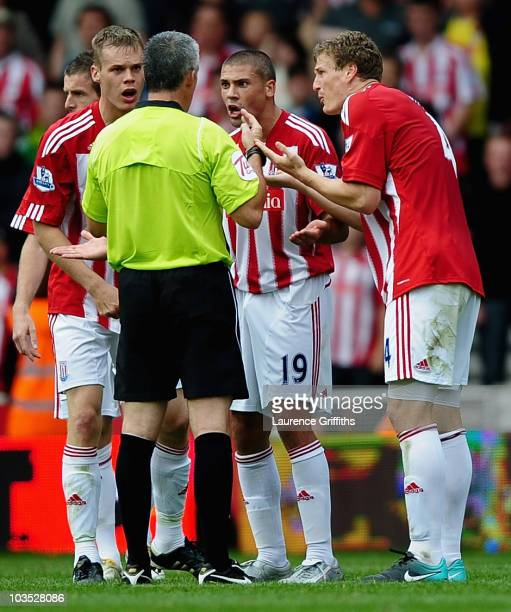 Ryan Shawcross Jonathan Walter and Robert Huth of Stoke City argue with Referee Chris Foy during the Barclays Premier League match between Stoke City...