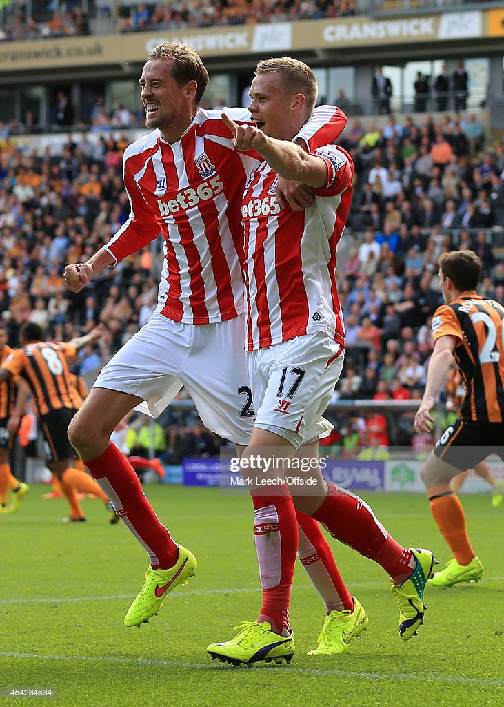 Ryan Shawcross of Stoke (R) celebrates with teammate Peter Crouch after scoring their 1st goal during the Barclays Premier League match between Hull City and Stoke City at the KC Stadium on August 24, 2014 in Hull, England.