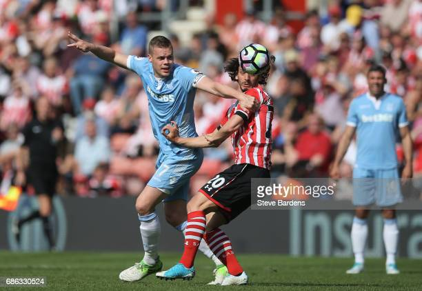 Ryan Shawcross of Stoke City and Manolo Gabbiadini of Southampton clash during the Premier League match between Southampton and Stoke City at St...