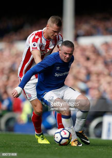 Ryan Shawcross of Stoke City and Wayne Rooney of Everton during the Premier League match between Everton and Stoke City at Goodison Park on August 12...