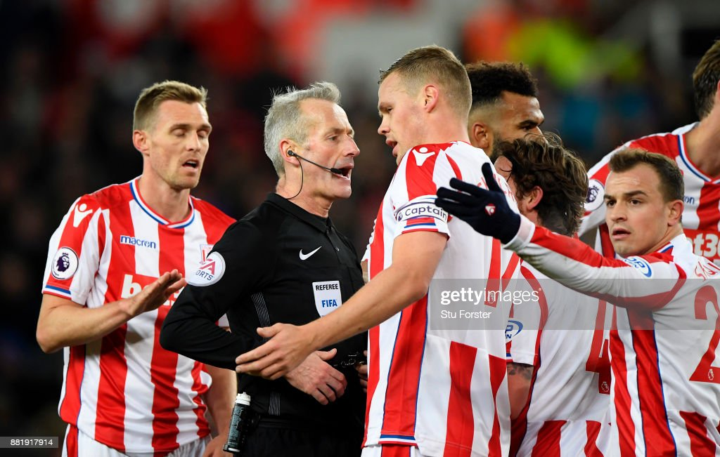 Ryan Shawcross of Stoke City argues with referee Martin Atkinson during the Premier League match between Stoke City and Liverpool at Bet365 Stadium on November 29, 2017 in Stoke on Trent, England.