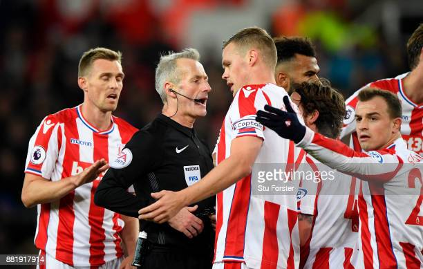 Ryan Shawcross of Stoke City argues with referee Martin Atkinson during the Premier League match between Stoke City and Liverpool at Bet365 Stadium...
