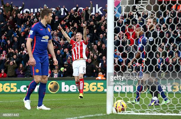 Ryan Shawcross of Stoke City celebrates scoring the first goal during the Barclays Premier League match between Stoke City and Manchester United at...