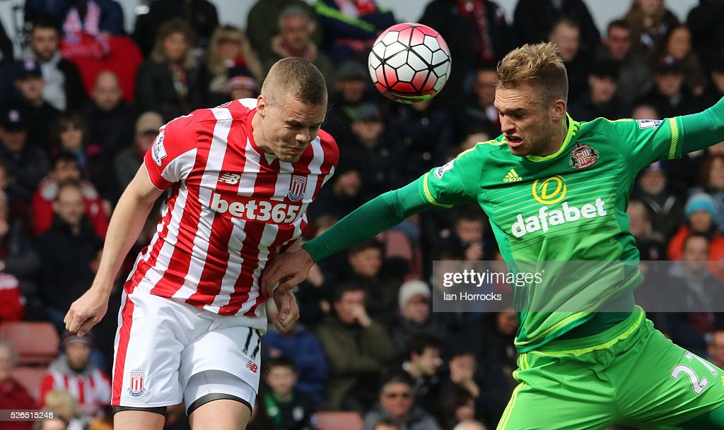 Ryan Shawcross (L) of Stoke City clears the ball from Jan Kirchhoff of Sunderland during the Barclays Premier League match between Stoke City and Sunderland at The Britannia Stadium on April 30, 2016 in Stoke on Trent , England.