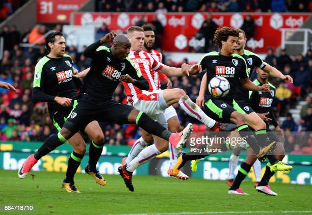 Ryan Shawcross of Stoke City get between Benik Afobe and Nathan Ake of AFC Bournemouth during the Premier League match between Stoke City and AFC...