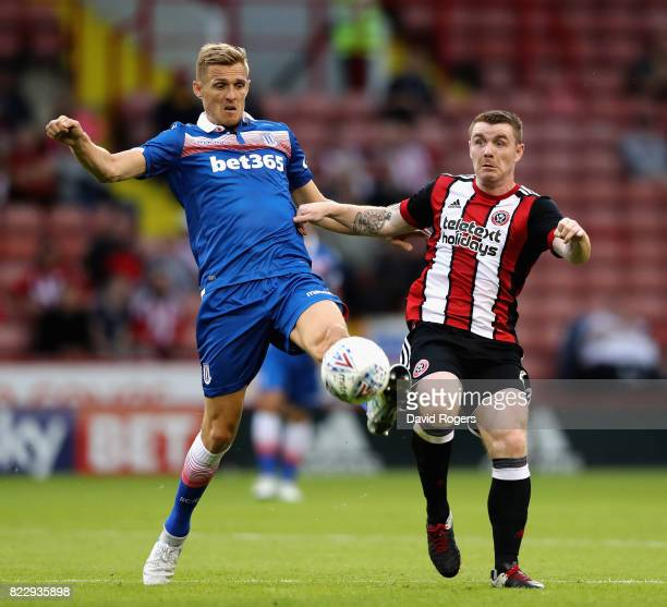 Ryan Shawcross of Stoke City is challenged by John Fleck during the pre season friendly match between Sheffield United and Stoke City at Bramall Lane...