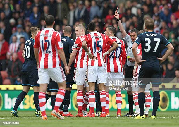 Ryan Shawcross of Stoke City is shown the red card by referee Andre Marriner during the Barclays Premier League match between Stoke City and...