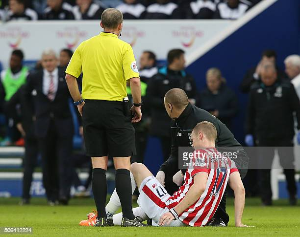 Ryan Shawcross of Stoke City lies injured before being replaced during the Barclays Premier League match between Leicester City and Stoke City at The...