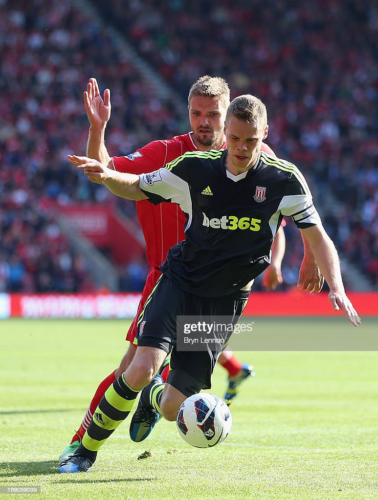 Ryan Shawcross of Stoke City tackles Jos Hooiveld of Southampton during the Barclays Premier League match between Southampton and Stoke City at St Mary's Stadium on May 19, 2013 in Southampton, England.