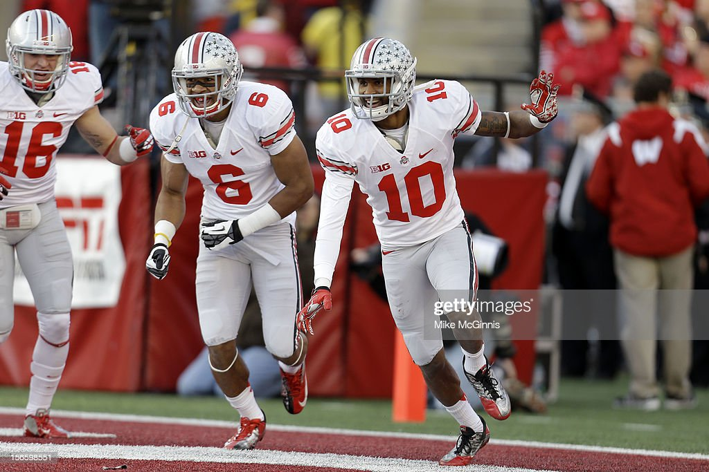 Ryan Shazier #10 of the Ohio State Buckeyes celebrates after scoring a touchdown during the first half against the Wisconsin Badgers at Camp Randall Stadium on November 17, 2012 in Madison, Wisconsin.