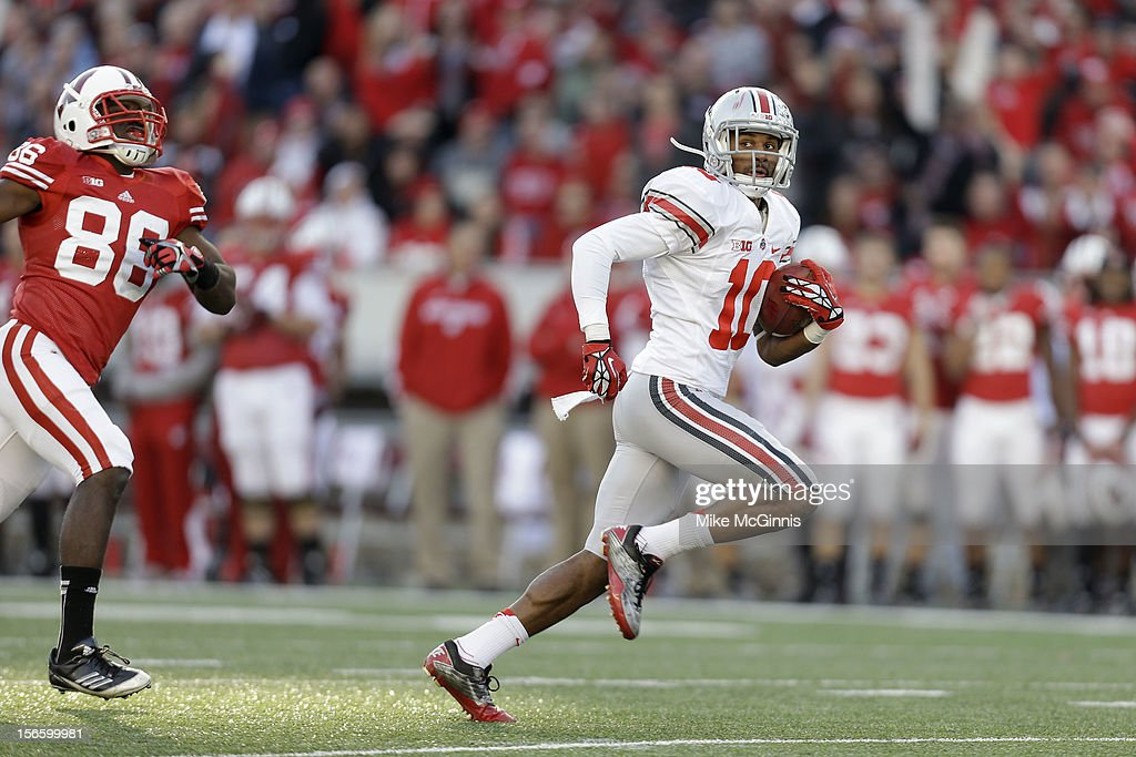 Ryan Shazier #10 of the Ohio State Buckeyes runs for a touchdown during the first half against the Wisconsin Badgers at Camp Randall Stadium on November 17, 2012 in Madison, Wisconsin.