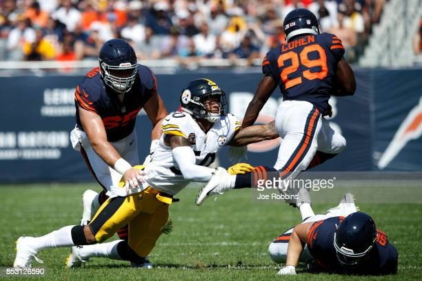 Ryan Shazier of the Pittsburgh Steelers attempts to grab Tarik Cohen of the Chicago Bears in the first quarter at Soldier Field on September 24 2017...