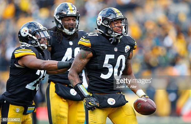 Ryan Shazier of the Pittsburgh Steelers reacts after he intercepted a pass thrown by Matt Moore of the Miami Dolphins in the third quarter during the...