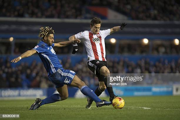 Ryan Shotton of Birmingham City gives away a penalty after tackling Lasse Vibe of Brentford during the Sky Bet Championship match between Birmingham...