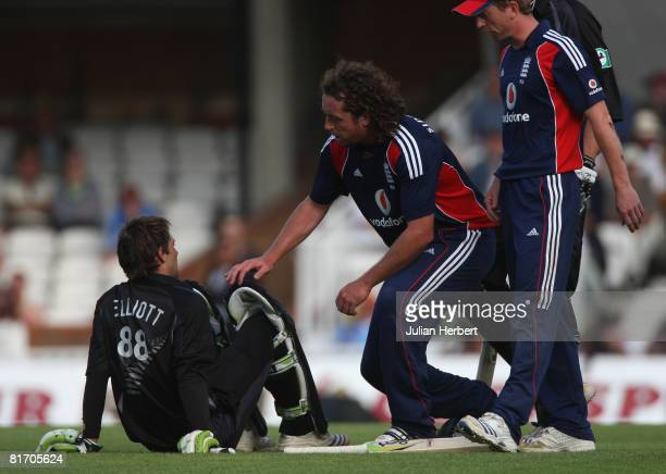 Ryan Sidebottom of England checks on Grant Elliott of New Zealand after they collided prior to Elliott being run out during the Fourth NatWest Series...