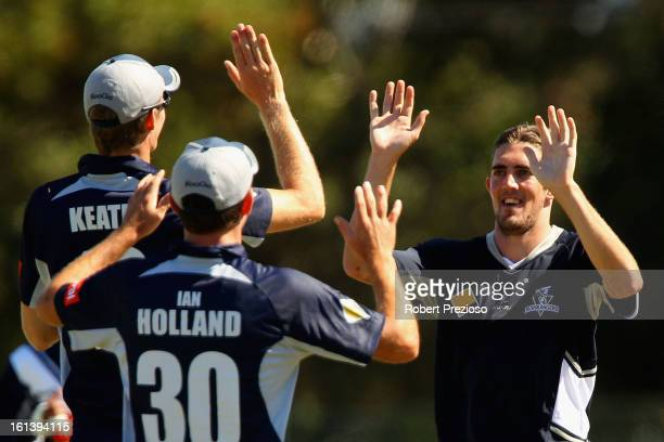 Ryan Sidebottom of the Bushrangers celebrates the wicket of James Vince of the Lions during the International Tour match between the Victoria...