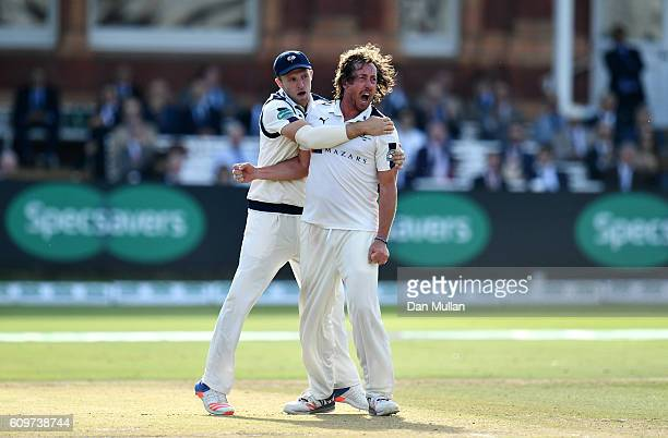 Ryan Sidebottom of Yorkshire celebrates with David Willey of Yorkshire after taking the wicket of Sam Robson of Middlesex during day three of the...