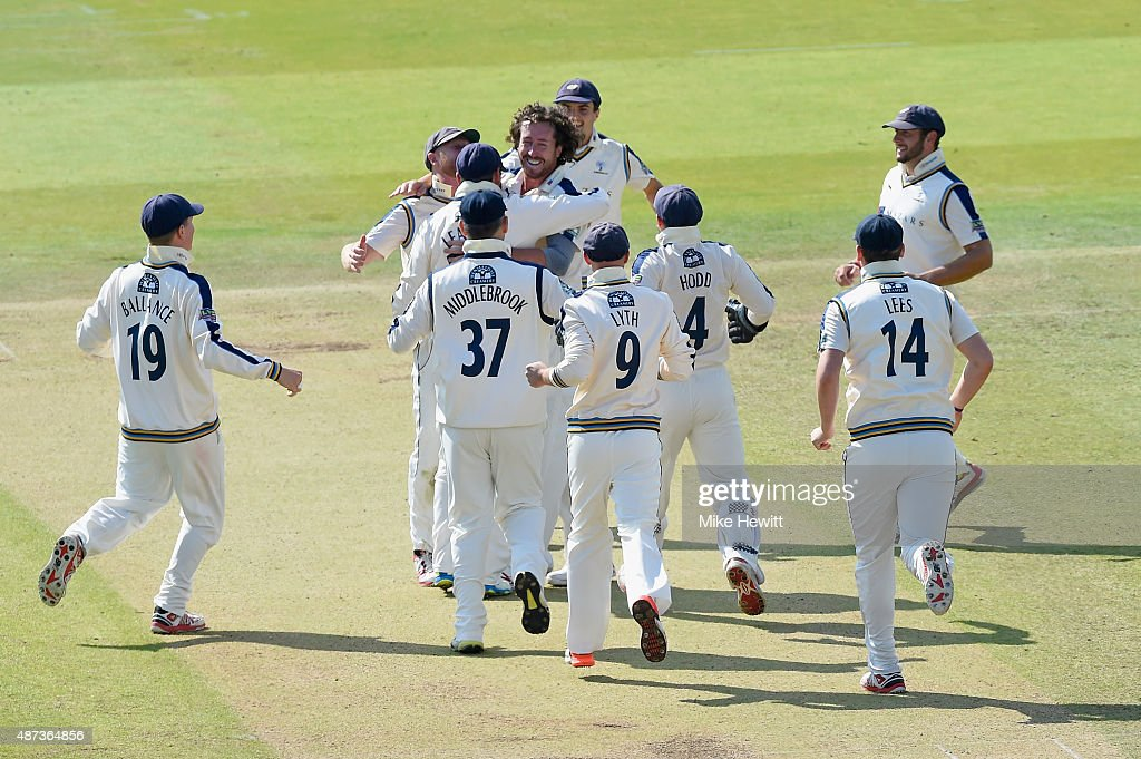 Ryan Sidebottom of Yorkshire is mobbed by team mates after claiming his fifth wicket by bowling Tim Murtagh of Middlesex during the LV County...