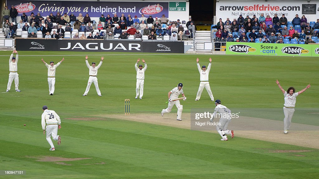 <a gi-track='captionPersonalityLinkClicked' href=/galleries/search?phrase=Ryan+Sidebottom&family=editorial&specificpeople=621602 ng-click='$event.stopPropagation()'>Ryan Sidebottom</a> (R) of Yorkshire unsuccessfully appeals for the wicket of Dawid Malan (4th R) of Middlesex during day two of the LV County Championship Division One match between Yorkshire and Middlesex at Headingley Stadium on September 18, 2013 in Leeds, England.