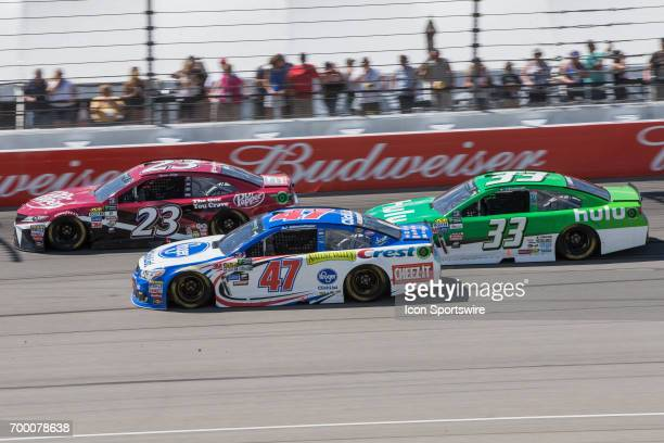 Ryan Sieg driver of the Dr Pepper Toyota AJ Allmendinger driver of the Kroger ClickList Chevrolet and Jeffrey Earnhardt driver of the Hulu Chevrolet...