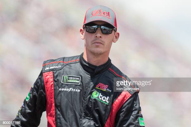 Ryan Sieg driver of the Dr Pepper Toyota greets fans during the driver introductions ceremony prior to the start of the Monster Energy Cup Series...