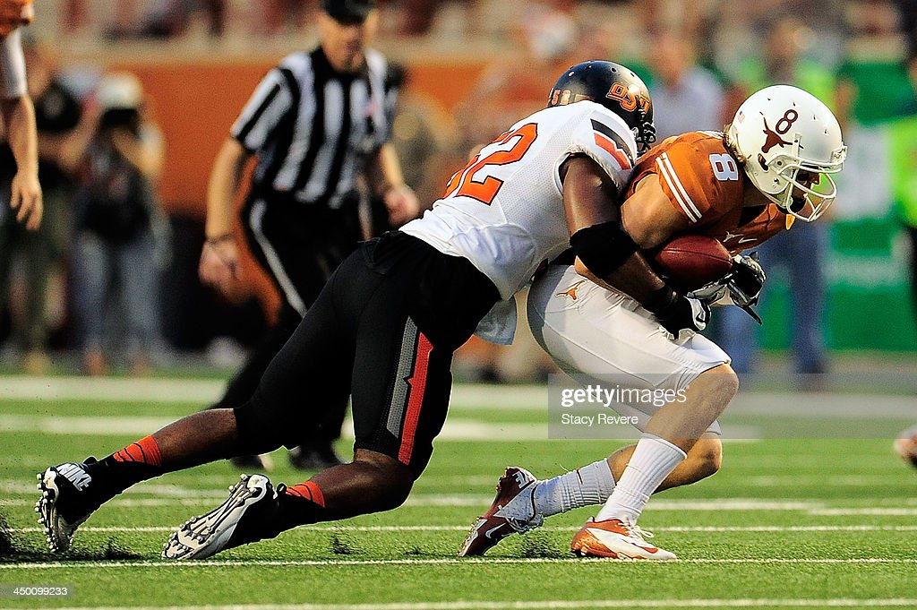 Ryan Simmons #52 of the Oklahoma State Cowboys brings down Jaxon Shipley #8 of the Texas Longhorns during a game at Darrell K Royal-Texas Memorial Stadium on November 16, 2013 in Austin, Texas. Oklahoma State won the game 38-13.
