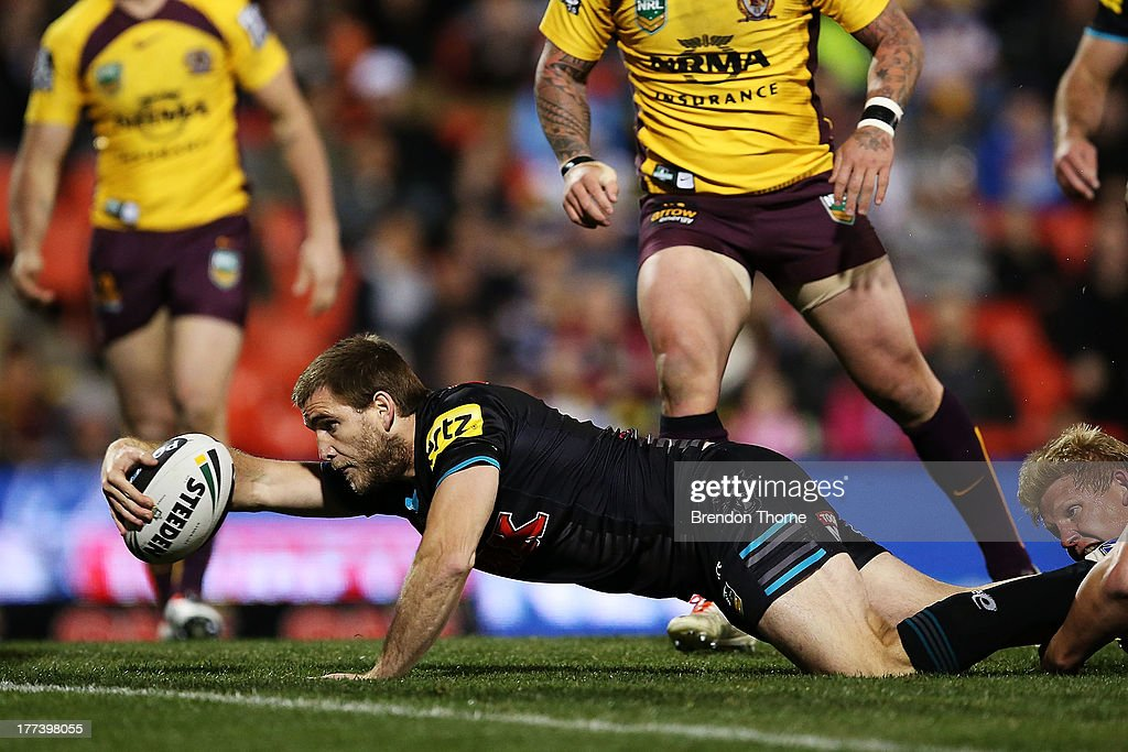 <a gi-track='captionPersonalityLinkClicked' href=/galleries/search?phrase=Ryan+Simpkins&family=editorial&specificpeople=5353377 ng-click='$event.stopPropagation()'>Ryan Simpkins</a> of the Panthers dives to score the opening try during the round 24 NRL match between the Penrith Panthers and the Brisbane Broncos at Centrebet Stadium on August 23, 2013 in Sydney, Australia.
