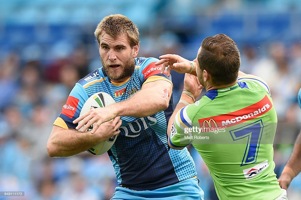 Ryan Simpkins of the Titans takes on the defence during the round 16 NRL match between the Gold Coast Titans and the Canberra Raiders at Cbus Super Stadium on June 26, 2016 in Gold Coast, Australia.
