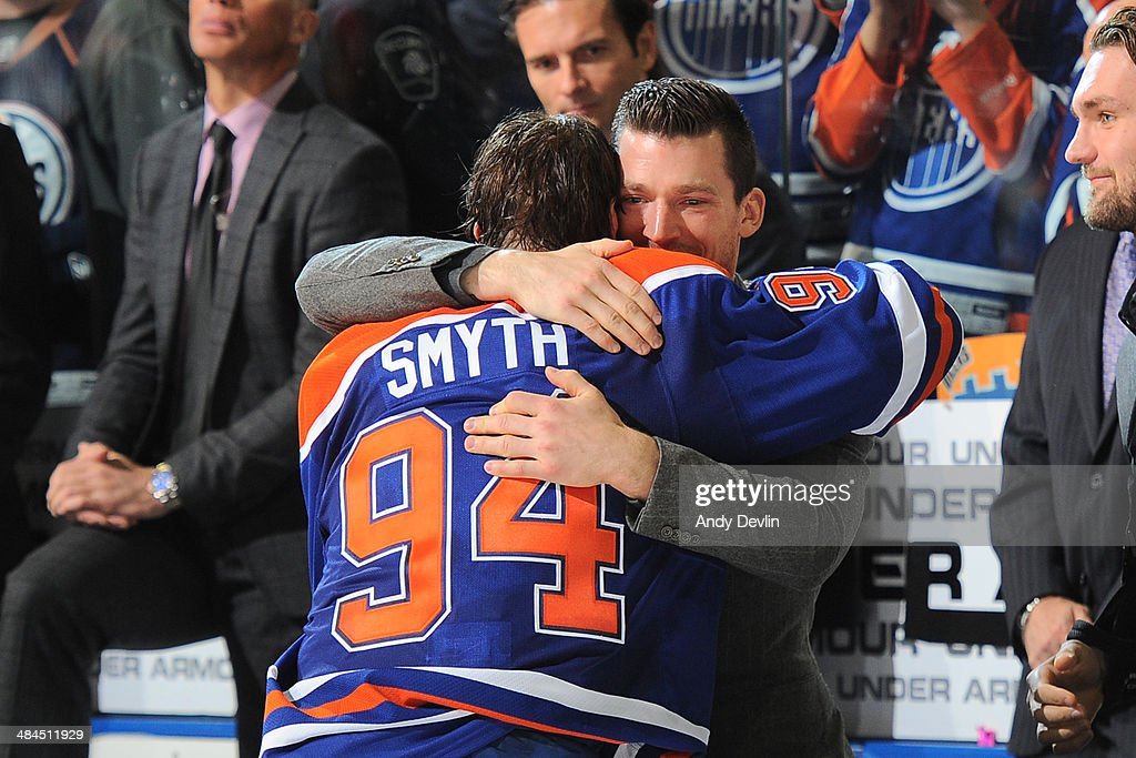 <a gi-track='captionPersonalityLinkClicked' href=/galleries/search?phrase=Ryan+Smyth+-+Ice+Hockey+Player&family=editorial&specificpeople=202567 ng-click='$event.stopPropagation()'>Ryan Smyth</a> #94 and <a gi-track='captionPersonalityLinkClicked' href=/galleries/search?phrase=Andrew+Ference&family=editorial&specificpeople=202264 ng-click='$event.stopPropagation()'>Andrew Ference</a> #21 of the Edmonton Oilers hug following the game against the Vancouver Canucks on April 12, 2014 at Rexall Place in Edmonton, Alberta, Canada.