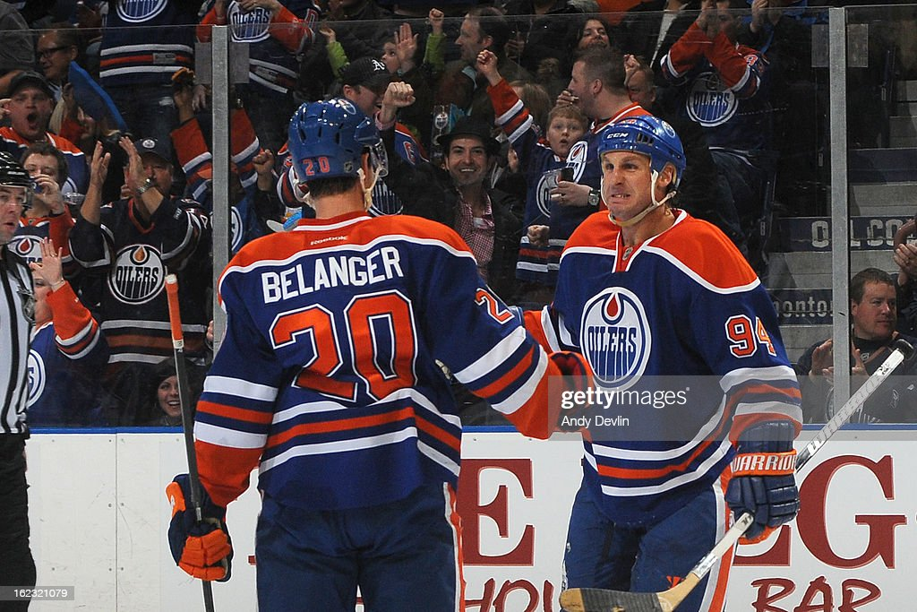 Ryan Smyth #94 and Eric Belanger #20 of the Edmonton Oilers celebrate after a goal in a game against the Minnesota Wild on February 21, 2013 at Rexall Place in Edmonton, Alberta, Canada.